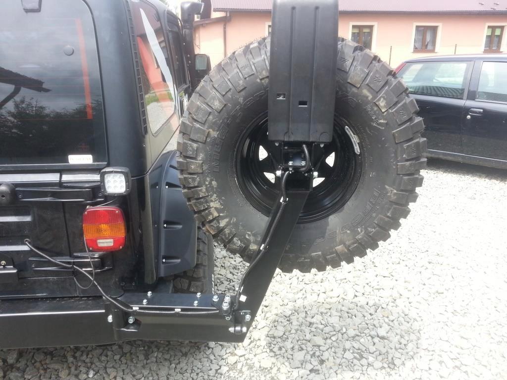 Как закрепить запасное колесо